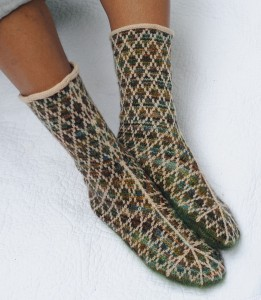 Fair Isle Trellis - The technique used here for the diamond trellis is two-color stranding, aka Fair Isle. The trellis lines arc gracefully up the leg from the sole and form half-stars over the toe.